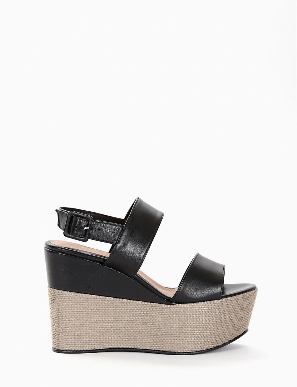 Sandalo zeppa 100 con fondo gomma e soletto in vera pelle nero