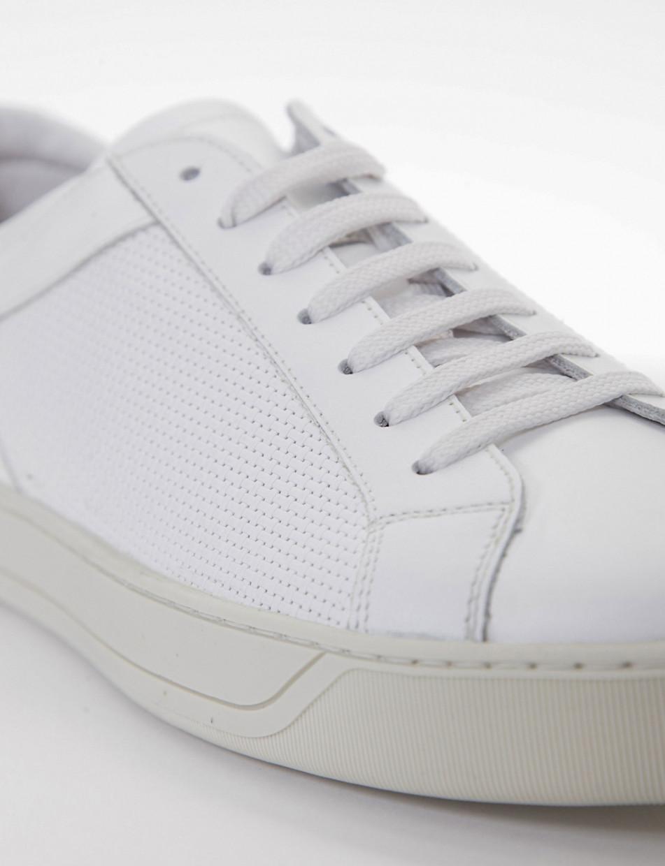 sneakers fondo gomma e soletto interno in vera pelle. Puntale e tallone in morbidissima pelle liscia bianco