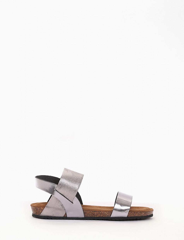 sandalo fondo gomma e soletto interno in vera pelle. Tomaia composa da due fasce una in pelle e laltra sul collo del piede in tessuto elasticizzato che permette una facile calzata acciaio