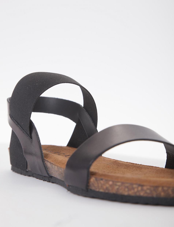 sandalo fondo gomma e soletto interno in vera pelle. Tomaia composa da due fasce una in pelle e laltra sul collo del piede in tessuto elasticizzato che permette una facile calzata nero