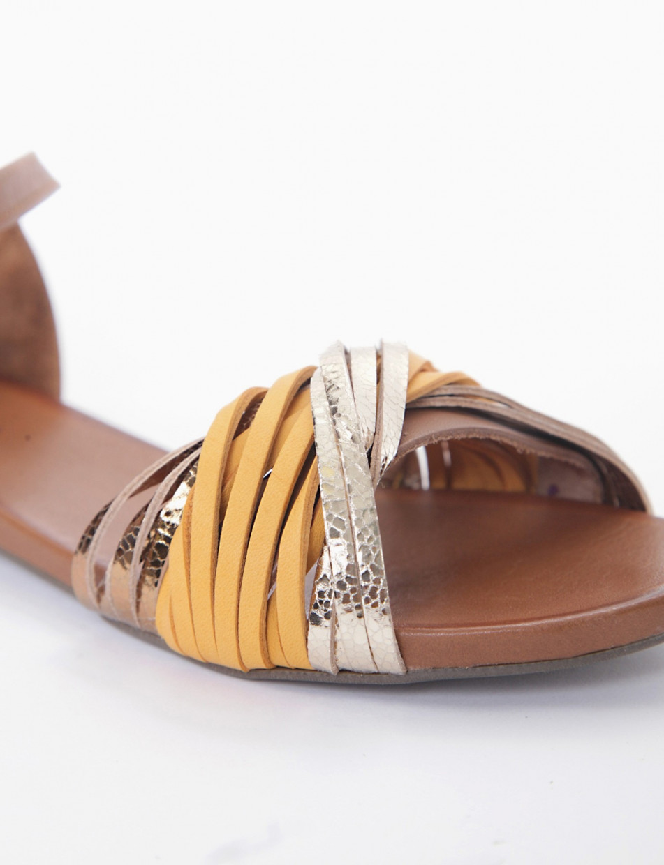 Low heel sandals gold leather